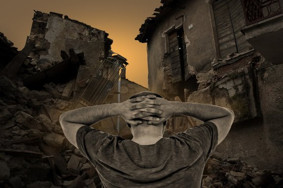 Destroyed-Houses-Man-Suffering